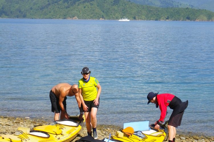 Packing sea kayaks on 3 day Outer-Queen Charlotte Sound Marlborough Sounds NZ