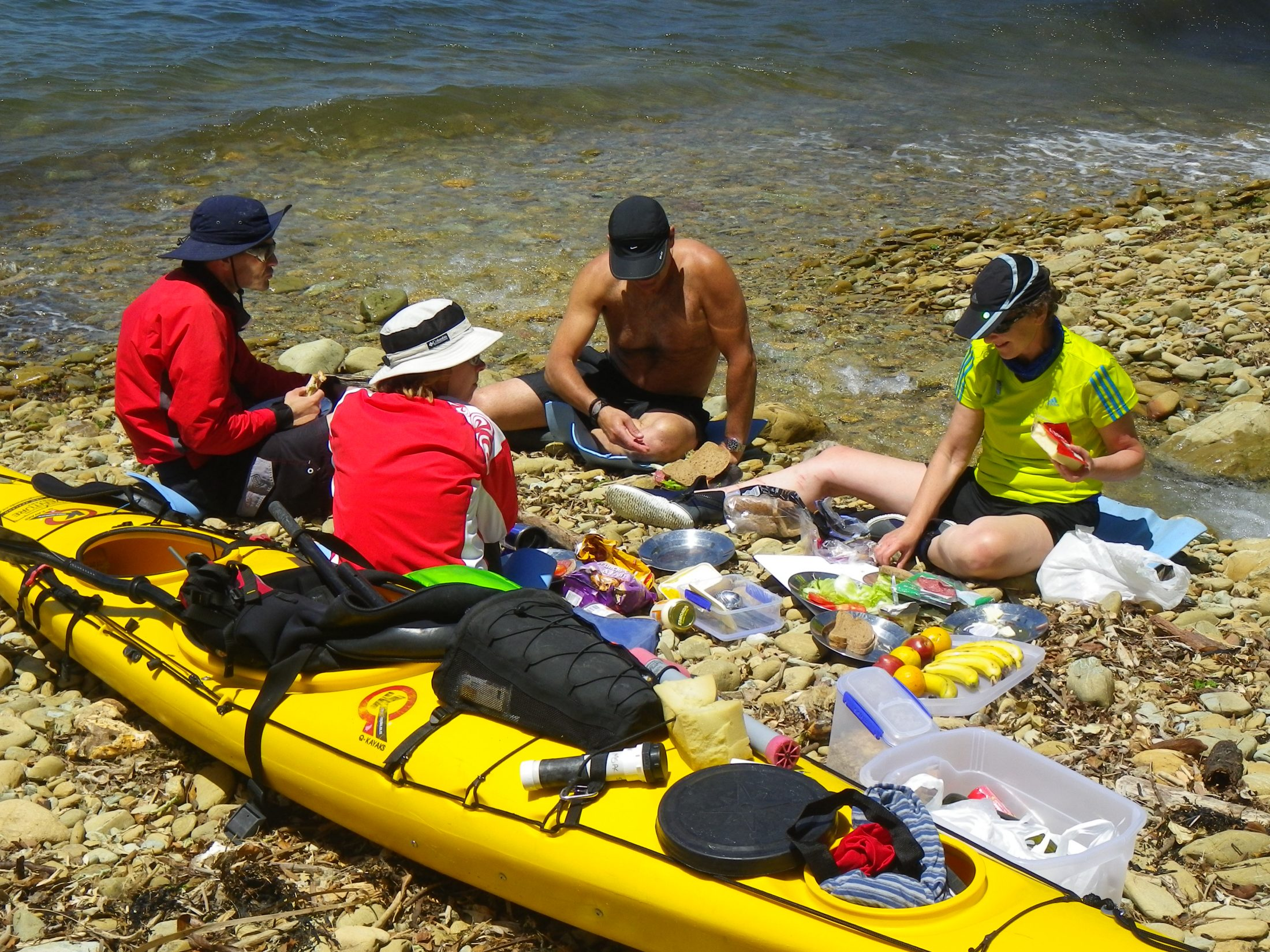 Lunch on the beach sea kayaking Queen Charlotte Sound Marlborough Sounds NZ